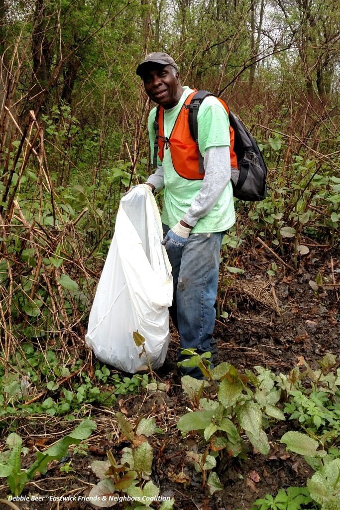 Getting dirty cleaning up Cobbs Creek